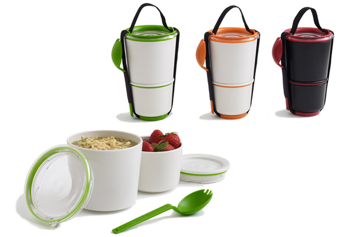 Two lunch containers, each with lids, stackable, held together with a strap which has a pocket for an included spork.