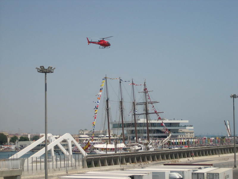 A helicopter hovers over Port America's Cup